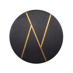 Bouton chic noir et or